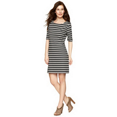 The classic black and white striped t shirt dress. Athletic Babes Score Big in a Cotton T Shirt Dress! You'll want to sport our athletic-infused shirtdresses all season long. Score major cool-girl points in a black long t shirt dress or a white t shirt maxi dress with slip-on sneakers. Or team your tee shirt dresses with a baseball cap.