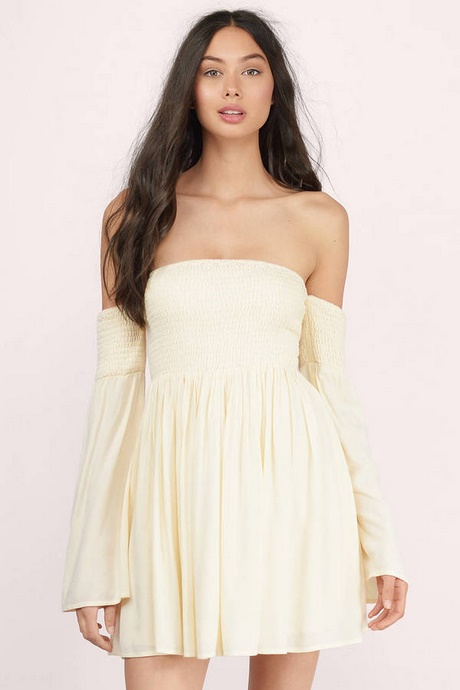 Dress has a deep sweetheart bodice with princess seams, double narrow straps that lead to an X back detail, and a high waist seam. Bodice leads to a flattering skater skirt. Dress is composed of a thick knit fabric that offers plenty of stretch.